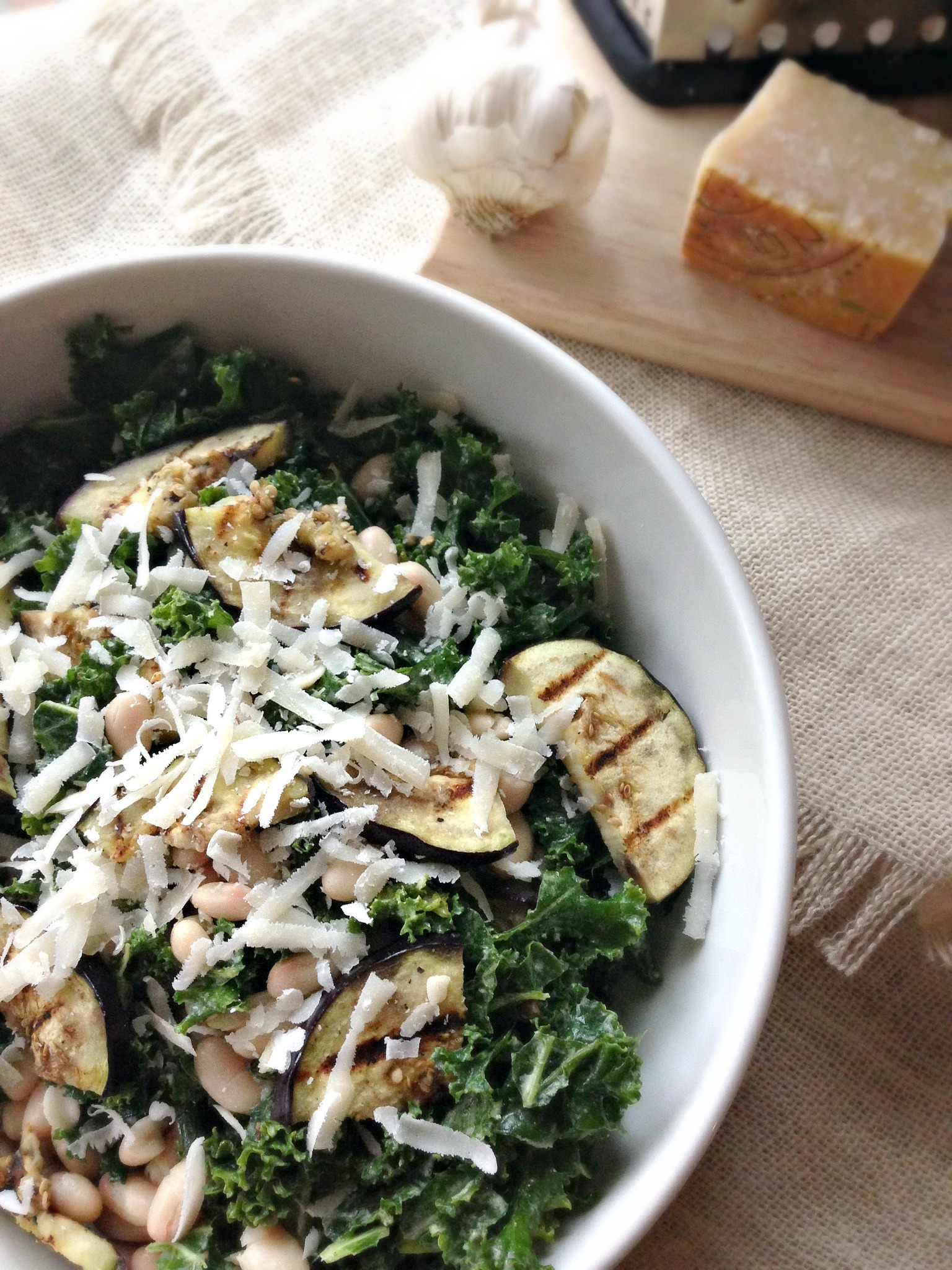 Grilled eggplant and cannellini beans tossed in garlicky kale topped ...