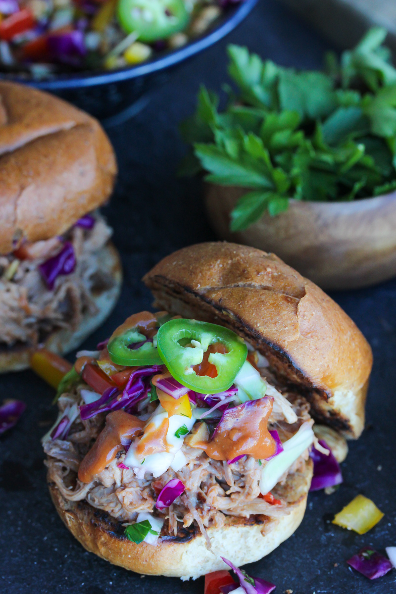 Slow Cooker Peanut BBQ Pulled Pork Sandwiches with Thai Ginger Slaw | dishingouthealth.com