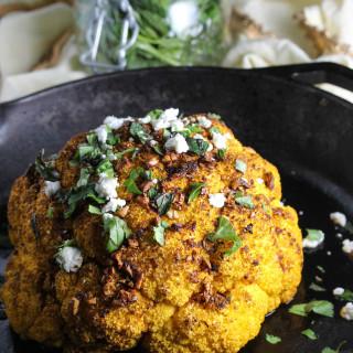 Garlic Harissa Roasted Whole Cauliflower with Goat Cheese
