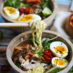 Slow Cooker Pork Ramen Bowls   Incredibly flavorful pork ramen bowls with all the fixings prepared in the slow cooker! This delicious recipe is simple to make and incredibly flavorful   dishingouthealth.com
