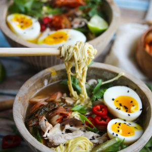 Slow Cooker Pork Ramen Bowls | Incredibly flavorful pork ramen bowls with all the fixings prepared in the slow cooker! This delicious recipe is simple to make and incredibly flavorful | dishingouthealth.com
