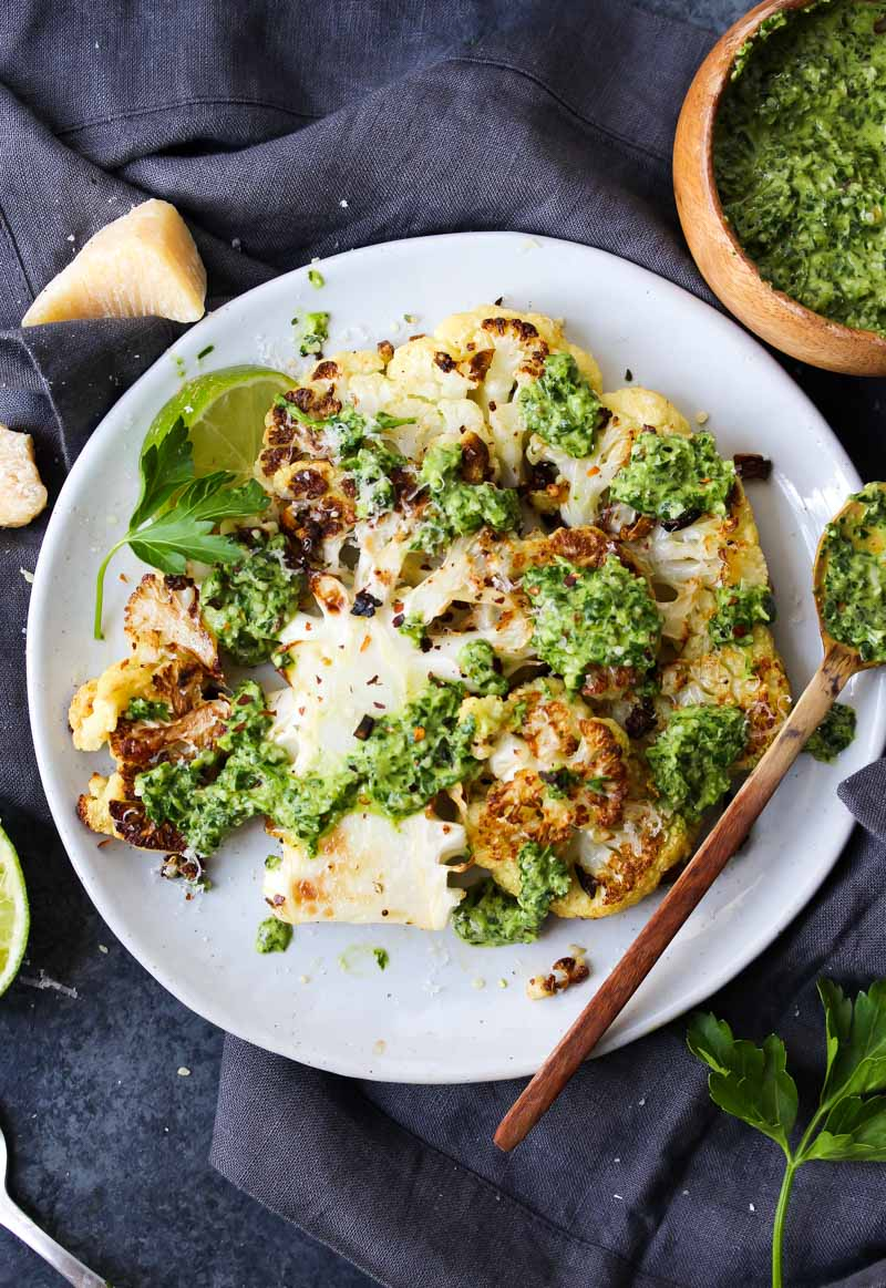 Roasted Cauliflower Steaks with Hemp Chimichurri | dishingouthealth.com