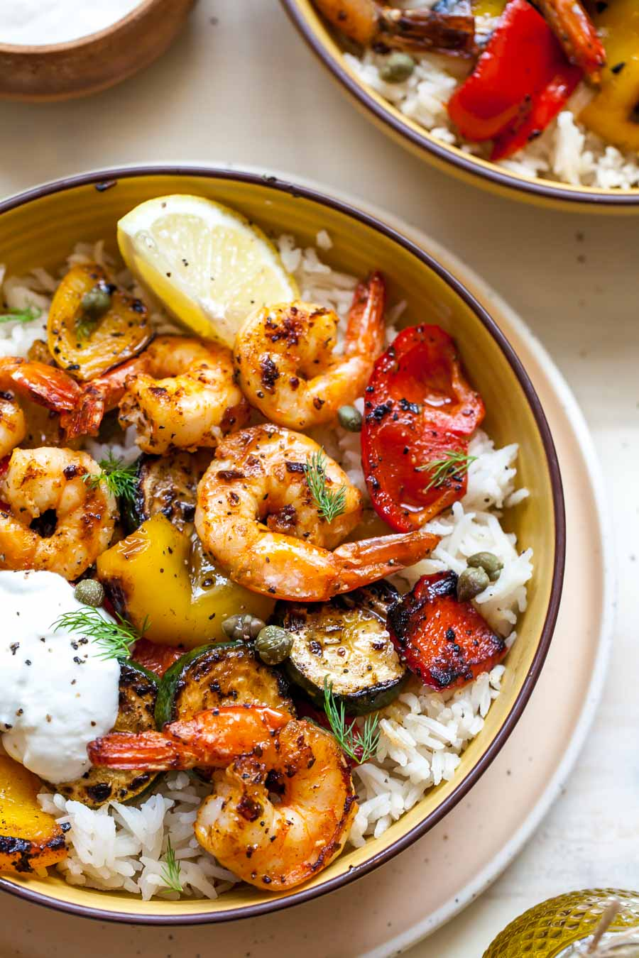 Shrimp, peppers, and rice in a yellow bowl