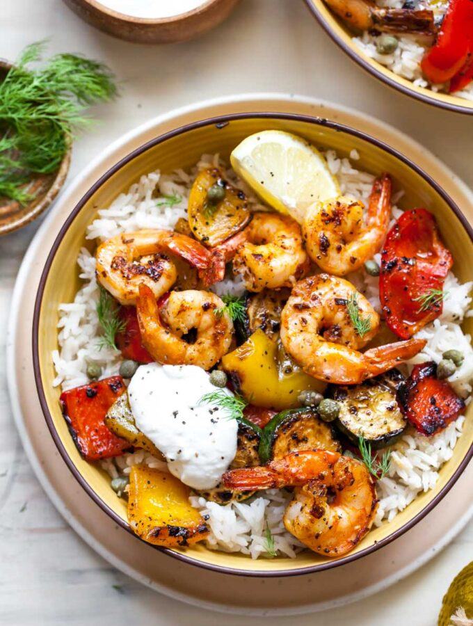 Shrimp and vegetables with rice in a bowl