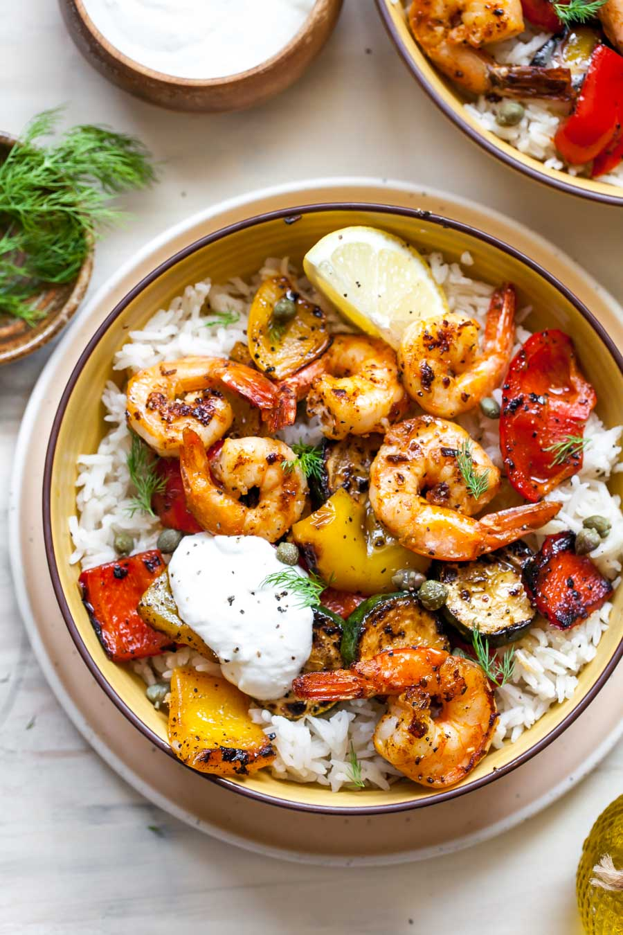 Shrimp and vegetables with rice on a plate
