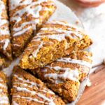 Gluten Free Carrot Cake Scones made with almond flour and topped with orange glaze