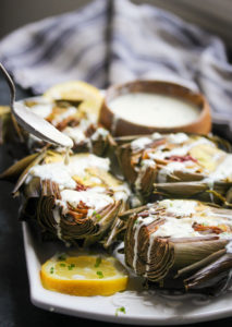 Roasted Artichokes with Herbed Buttermilk Dressing | dishingouthealth.com