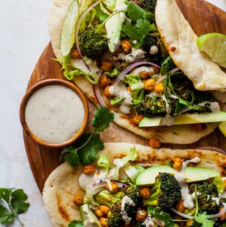 Buffalo Broccoli and Chickpea Pitas with Tahini Caesar