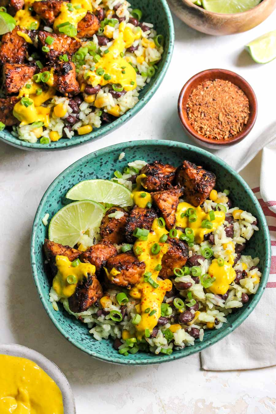 Jerk-spiced tempeh grain bowls with mango-tahini sauce
