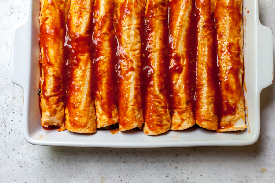 Filled enchiladas with red sauce