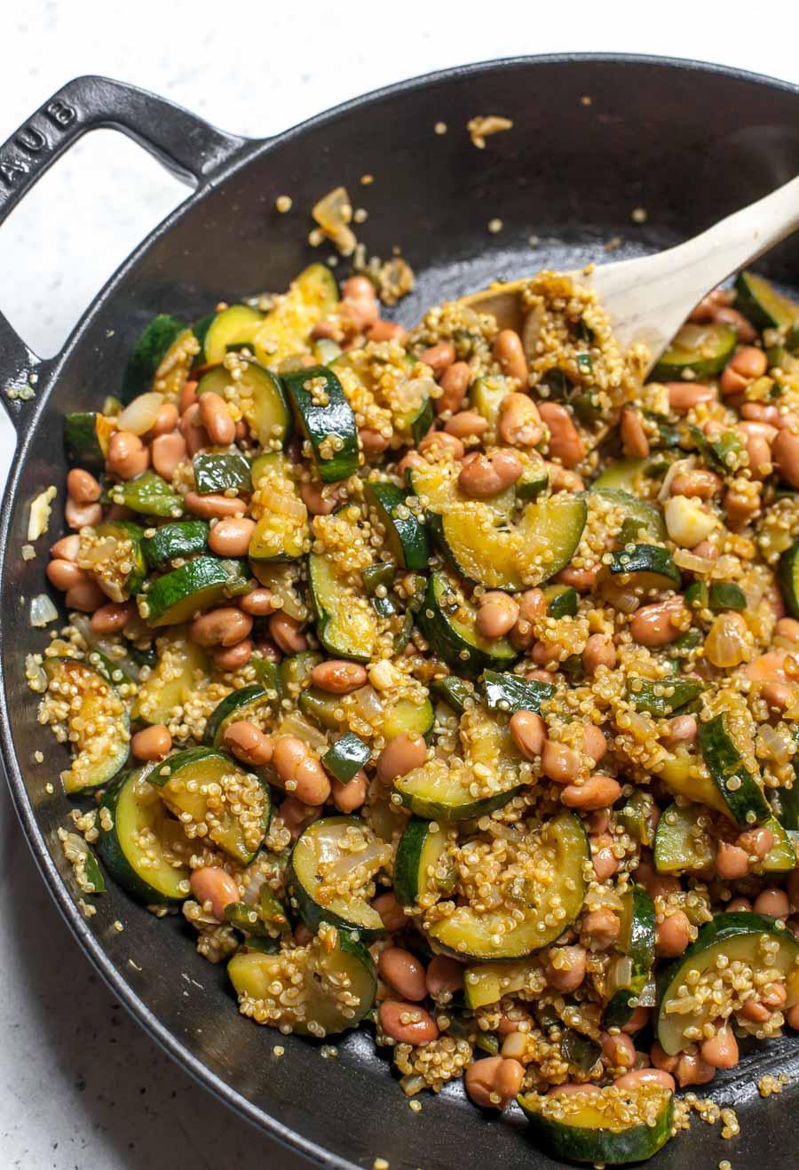 Sautéed vegetables, quinoa, and pinto beans