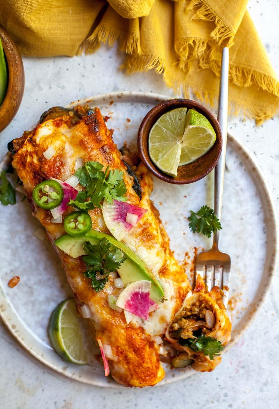 Single portion of enchiladas with garnishes