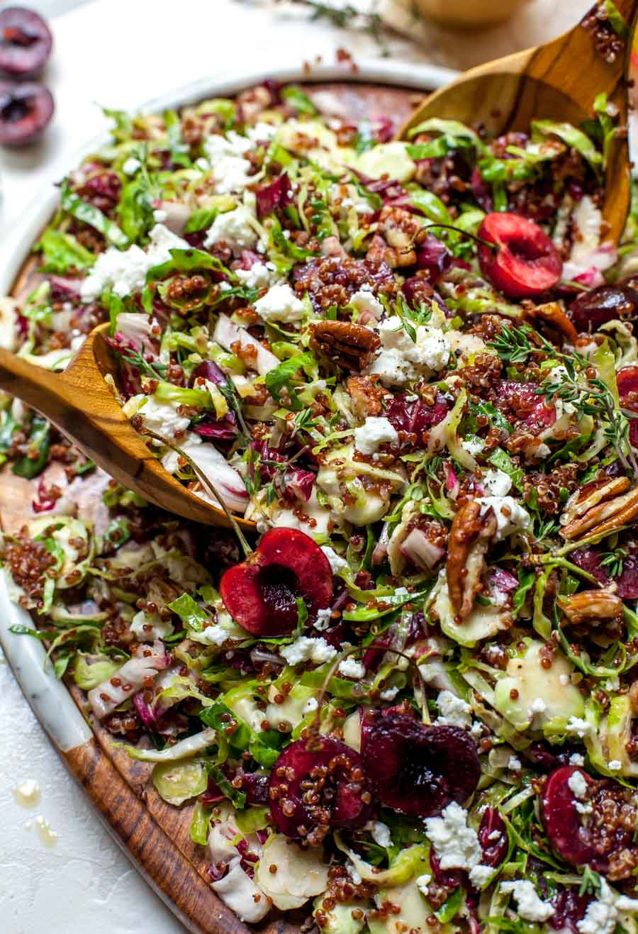 Brussels and Quinoa Salad with Cherries, Goat Cheese, Pecans, and Maple-Mustard Dressing