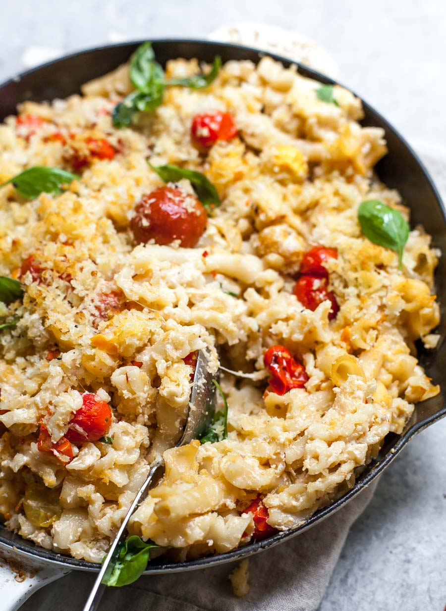 Skillet of Mac and Cheese with Burst Tomatoes and Basil