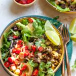 Taco Salads with Chopped Veggie Burgers, Black Beans, and Chipotle-Tahini Dressing