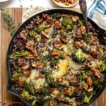 One Skillet Rice Casserole with Cheesy Broccoli, Wild Mushrooms, and Toasted Pecans