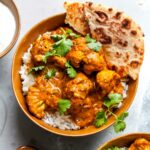 Vegetarian Butter Cauliflower recipe served over basmati rice with yogurt and naan