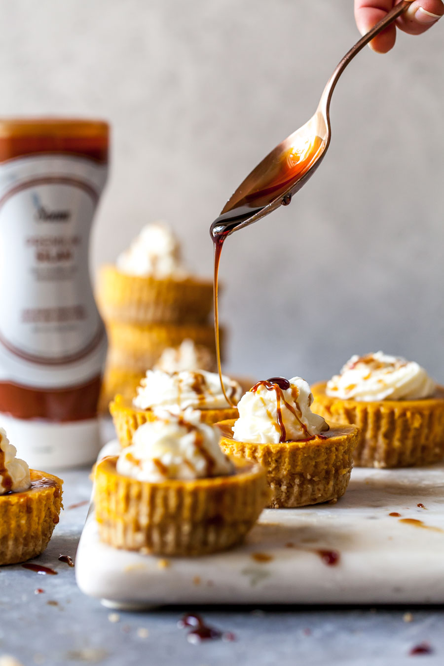 Soom Silan Date Syrup Drizzled over Pumpkin Cheesecakes