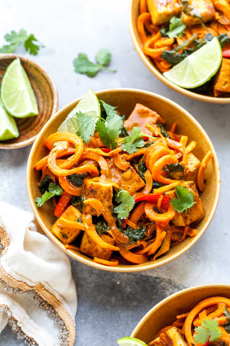 Gluten free sweet potato noodles with Thai curry sauce and crispy tofu