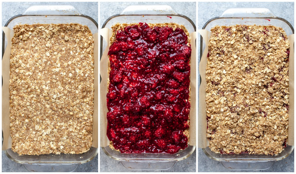 Oat crumble and berry mixture being layered in a pan