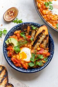 Poached Eggs in Curried Tomato Sauce with Beans