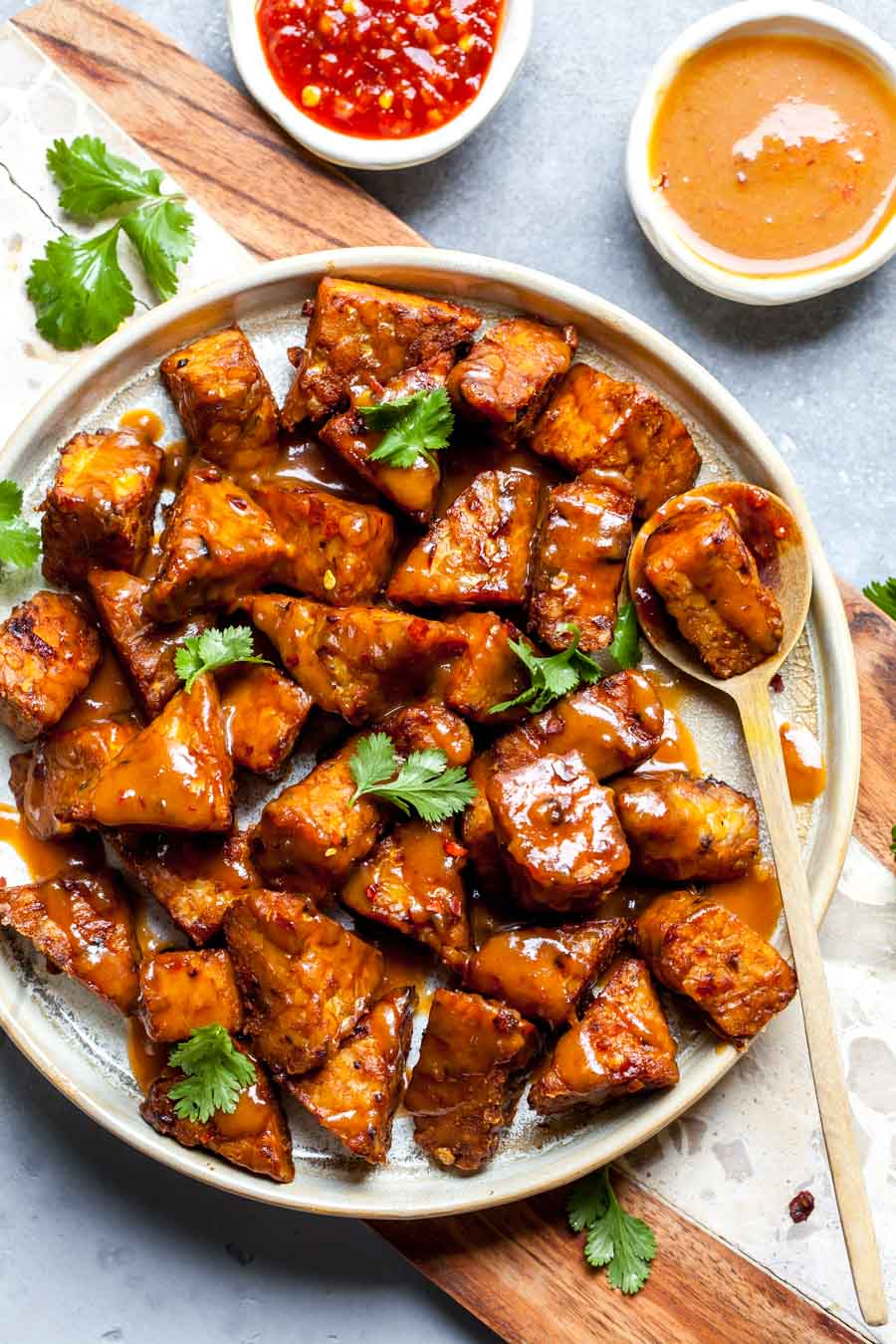 Soy-marinated tempeh topped with peanut-ginger sauce