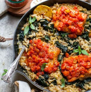 Salmon and orzo topped with tomato bruschetta