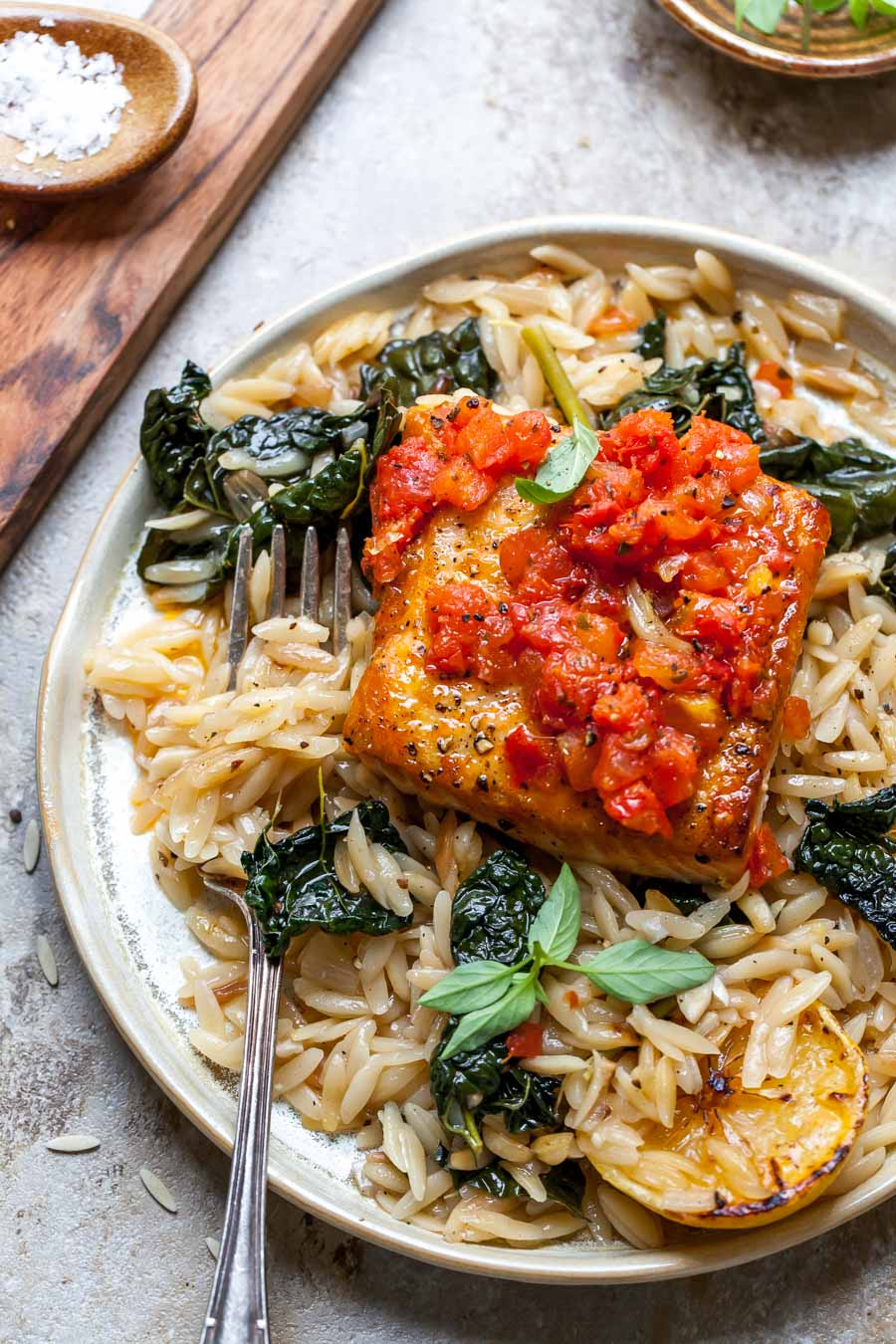Salmon served with orzo on a plate