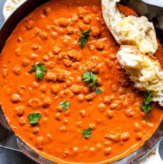 Chickpeas in red pepper sauce in a skillet