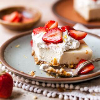 Strawberry cheesecake bar with bite taken