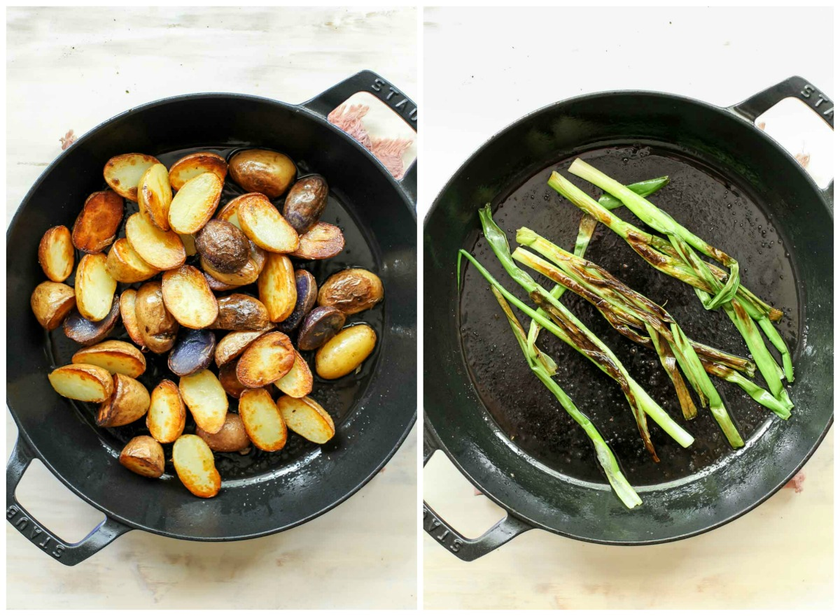 Seared potato halves in a skillet next to charred scallions in a skillet