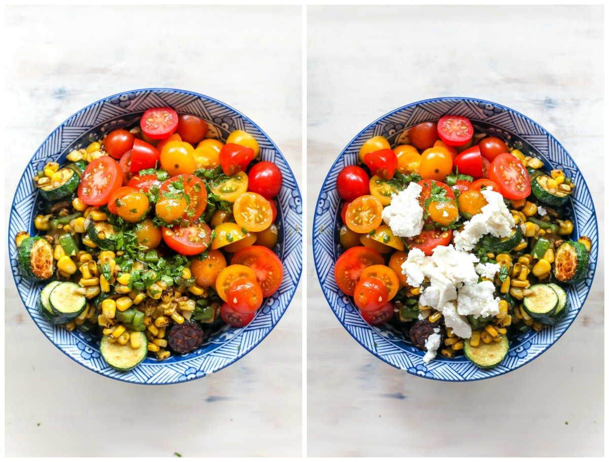 Tomato, corn, and zucchini salad being topped with feta cheese and dressing