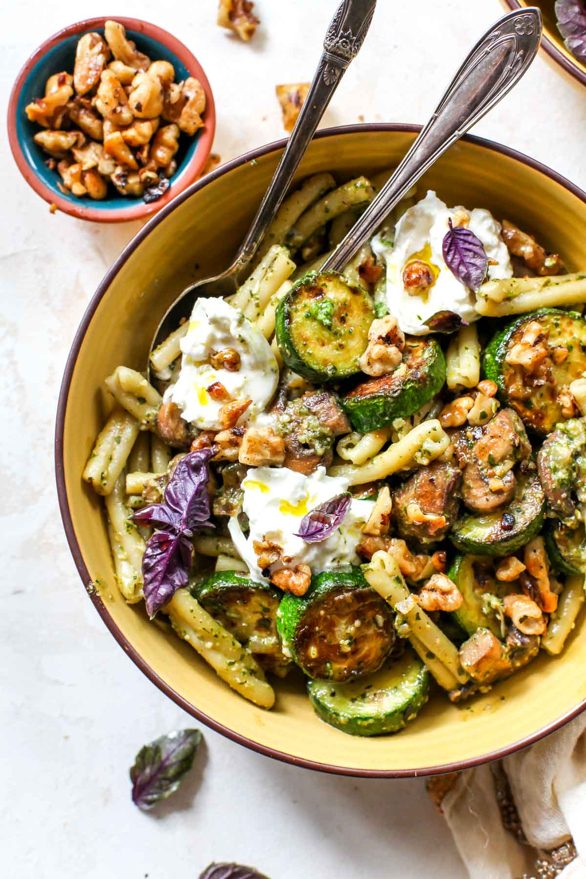 zucchini pesto pasta with buttery mushrooms and walnuts