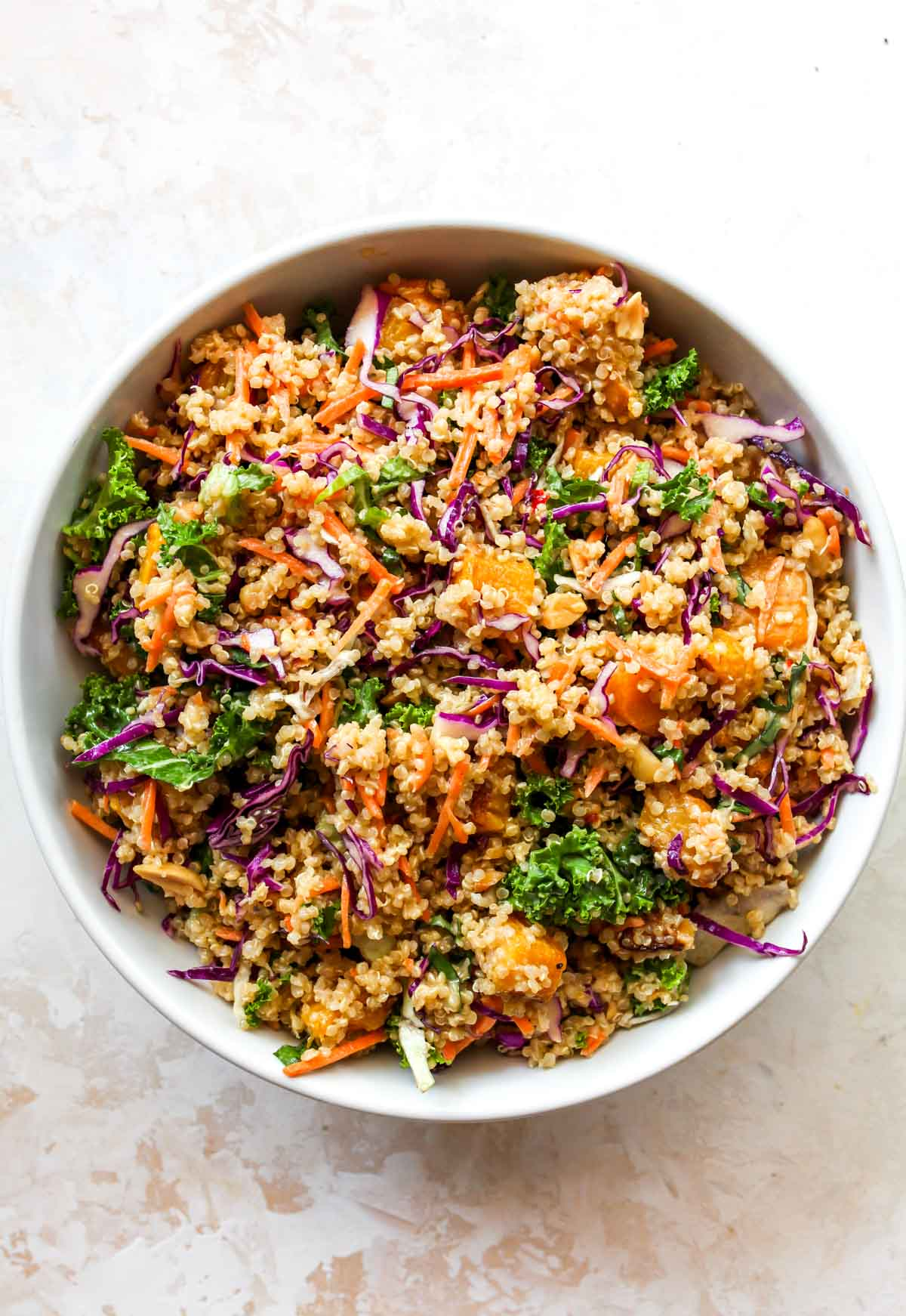 Butternut squash quinoa salad mixed together in a white bowl