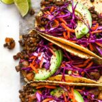 Lentil and mushroom tacos topped with cabbage slaw