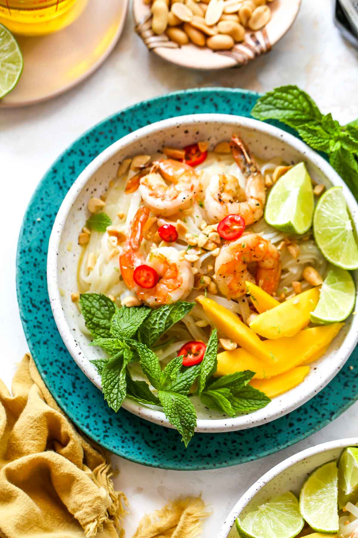 Sauteed shrimp over glass noodles in a white bowl