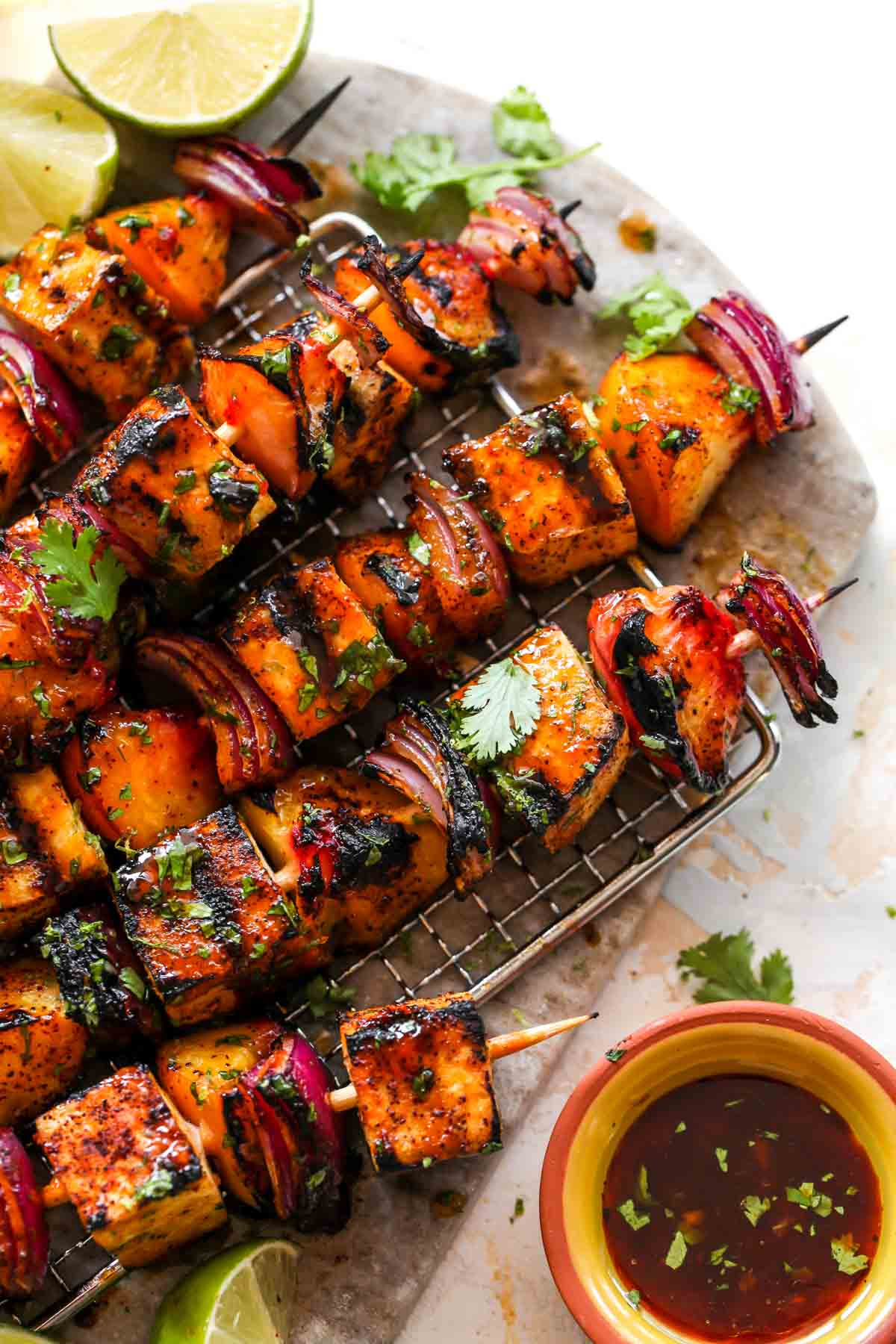 Tofu skewers topped with chili glaze and cilantro
