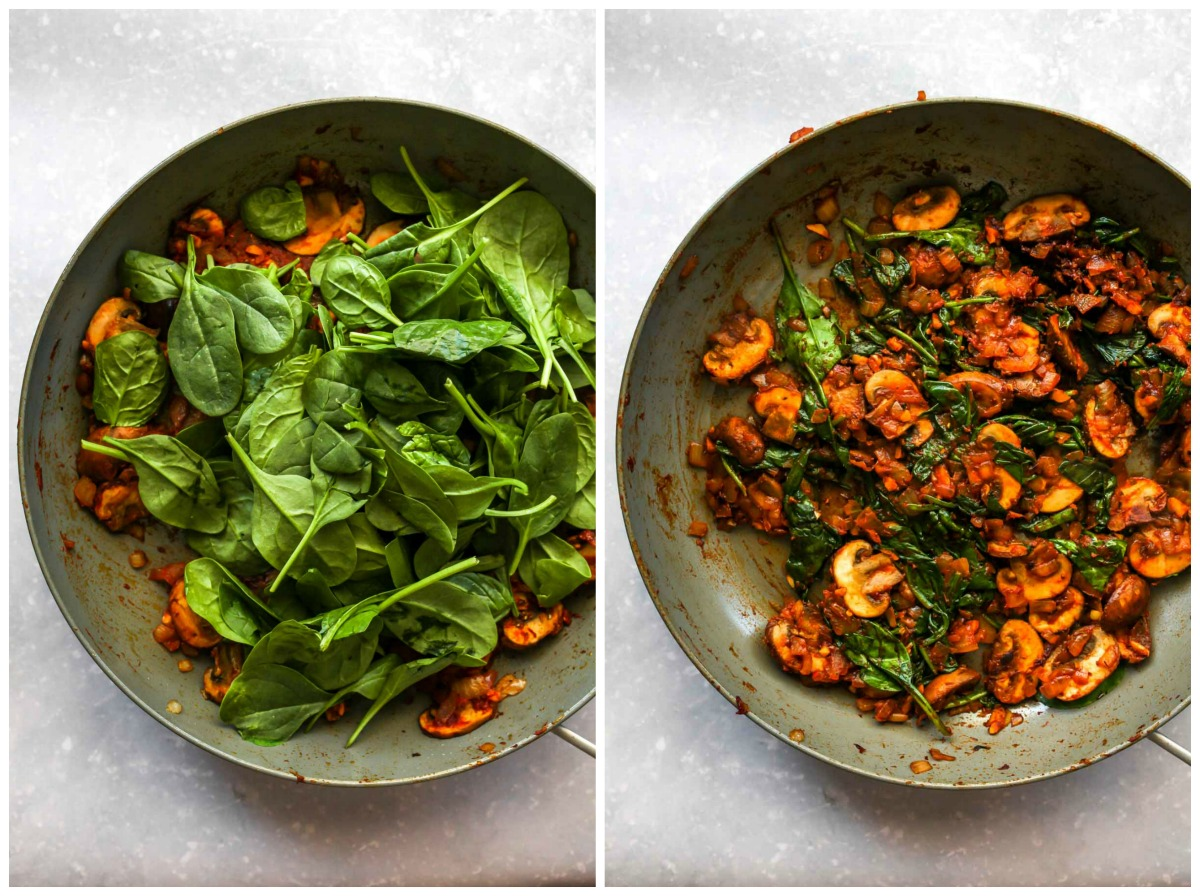 Fresh spinach being mixed into a skillet of mushrooms and onions