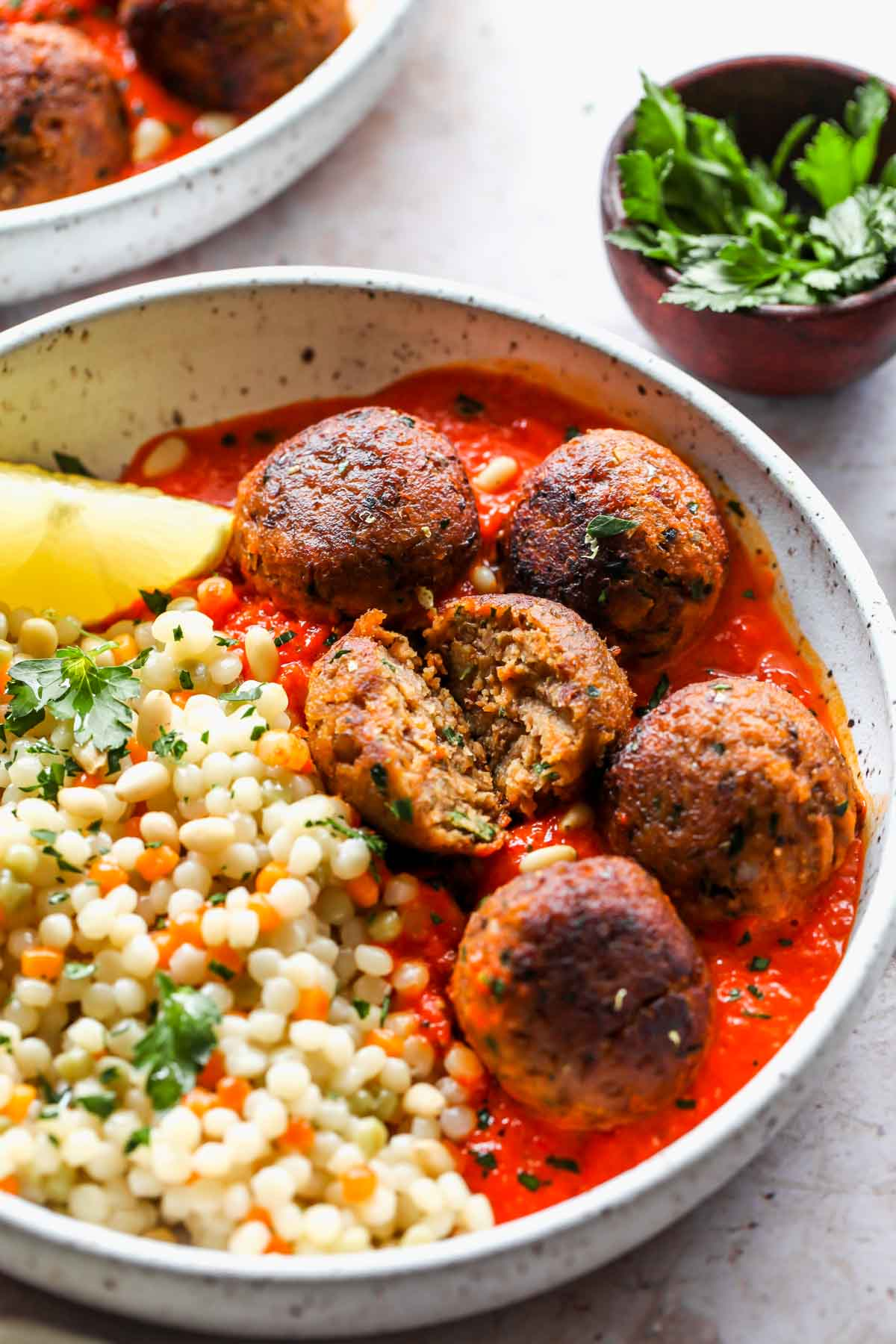 Lentil meatball being cut in half