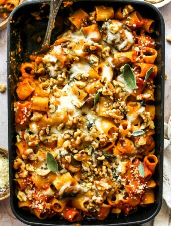 Cheesy pumpkin pasta bake with mushrooms, spinach, creamy pumpkin tomato sauce