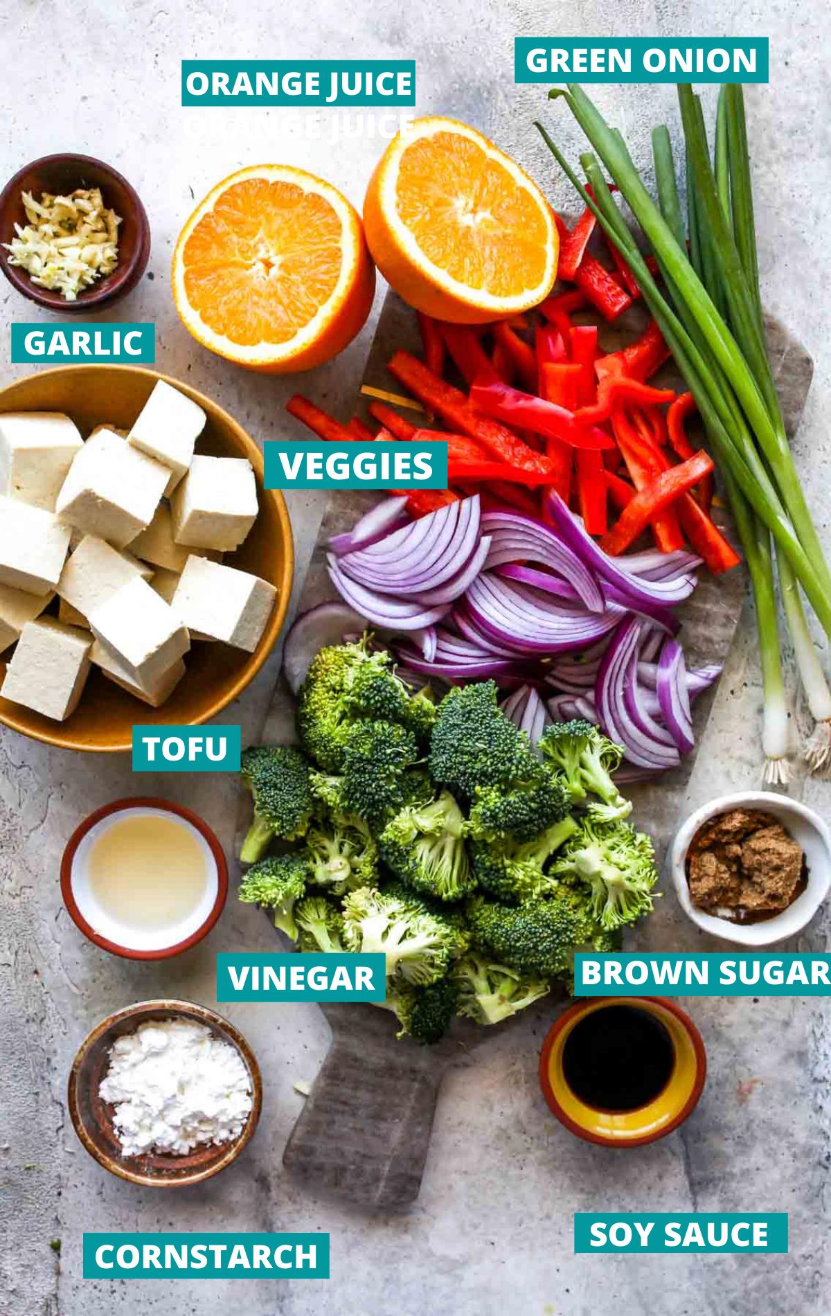 Vegan orange chicken ingredients in separate bowls with blue labels