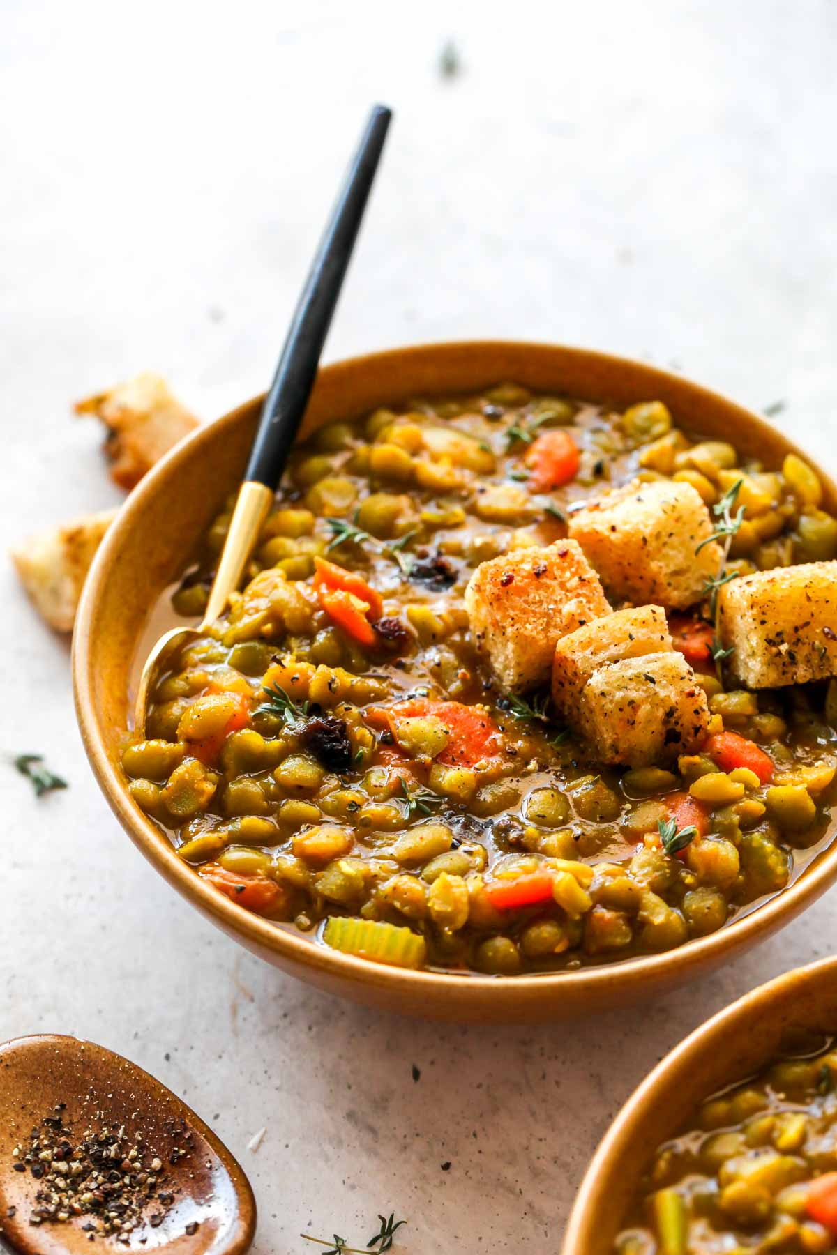 Moroccan Split Pea Soup served with raisins in a gold bowl
