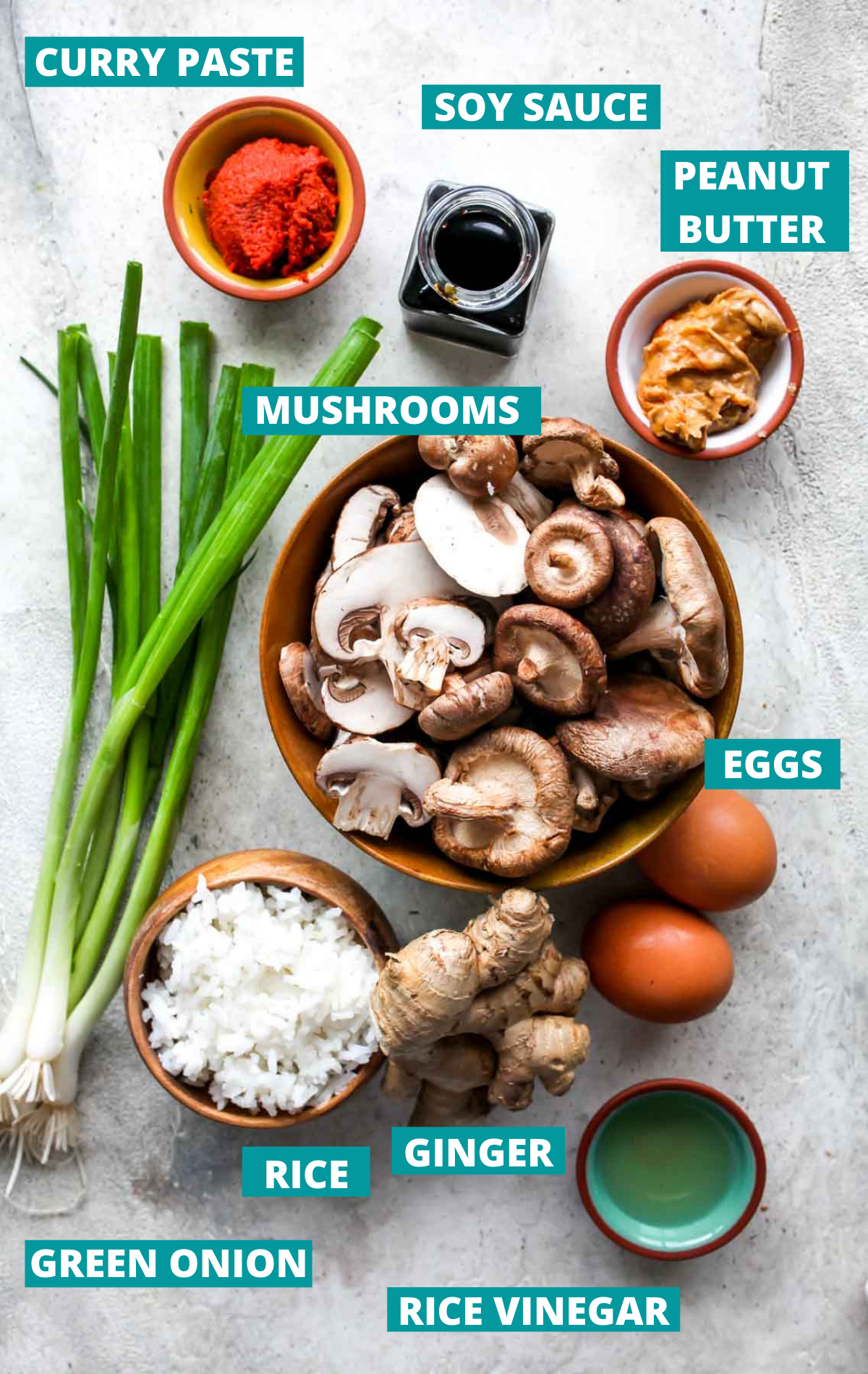 Mushroom fried rice ingredients in separate bowls with blue labels