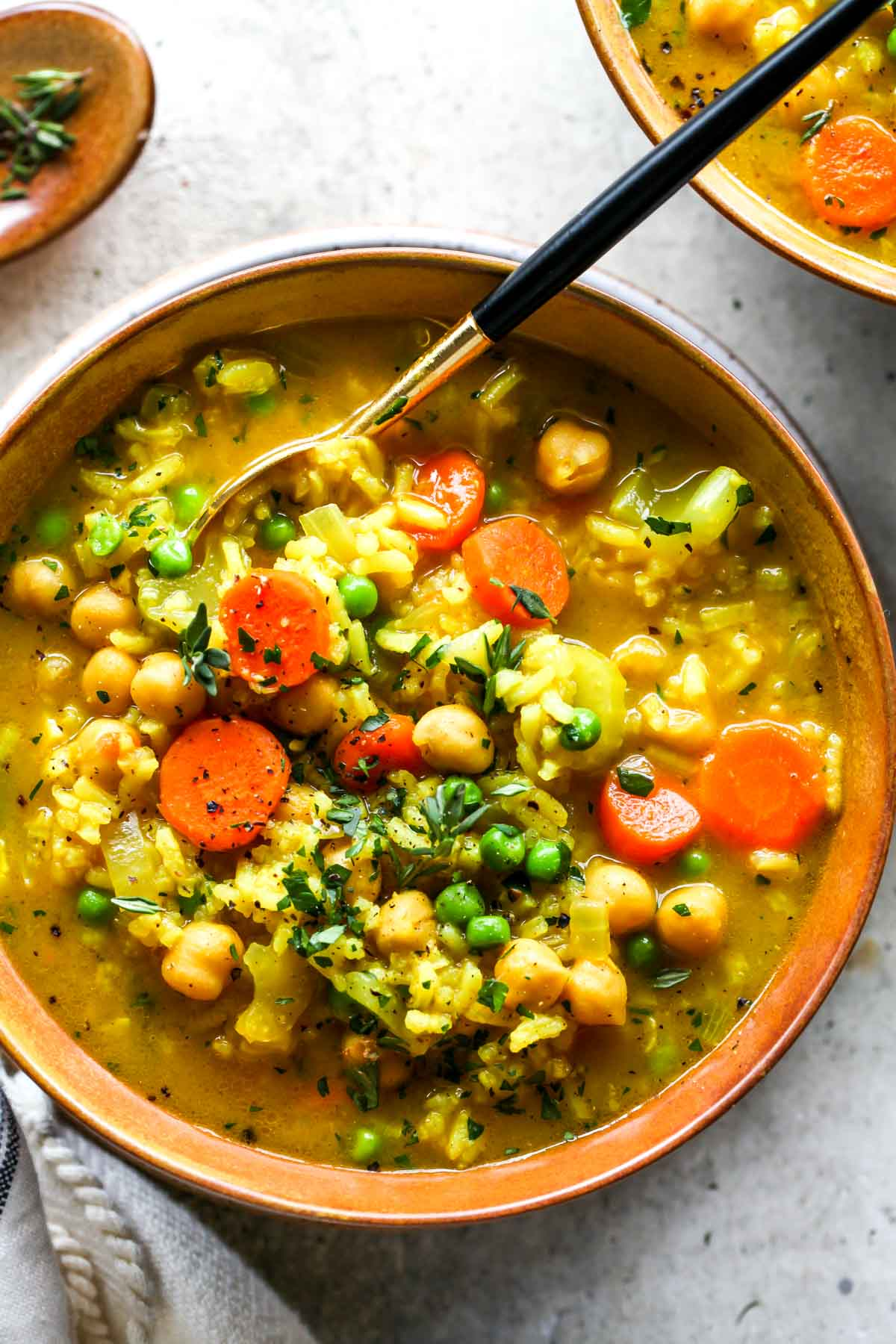 Chickpea and rice soup with a spoon removing a spoonful