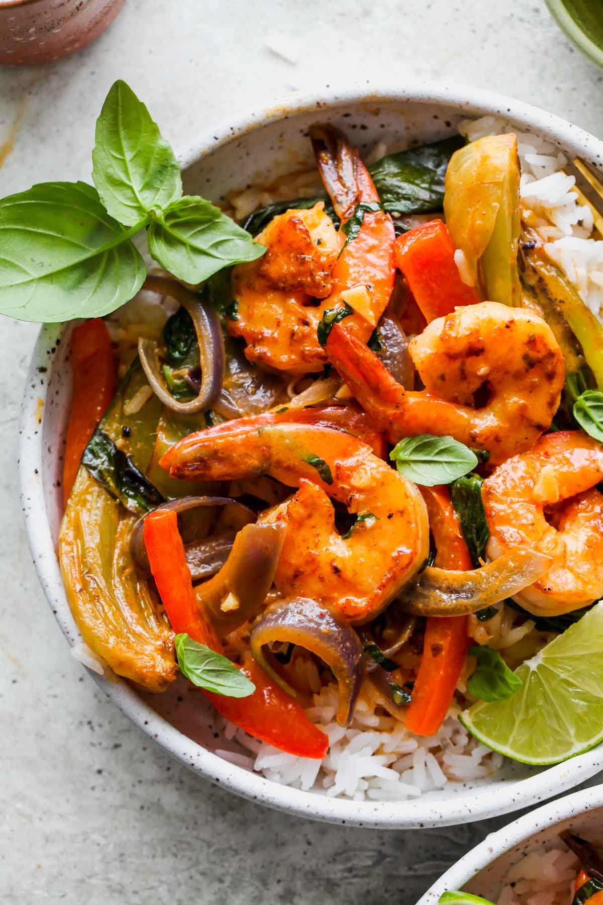 Pan-seared shrimp, peppers, and bok choy tossed in curry sauce and served over rice