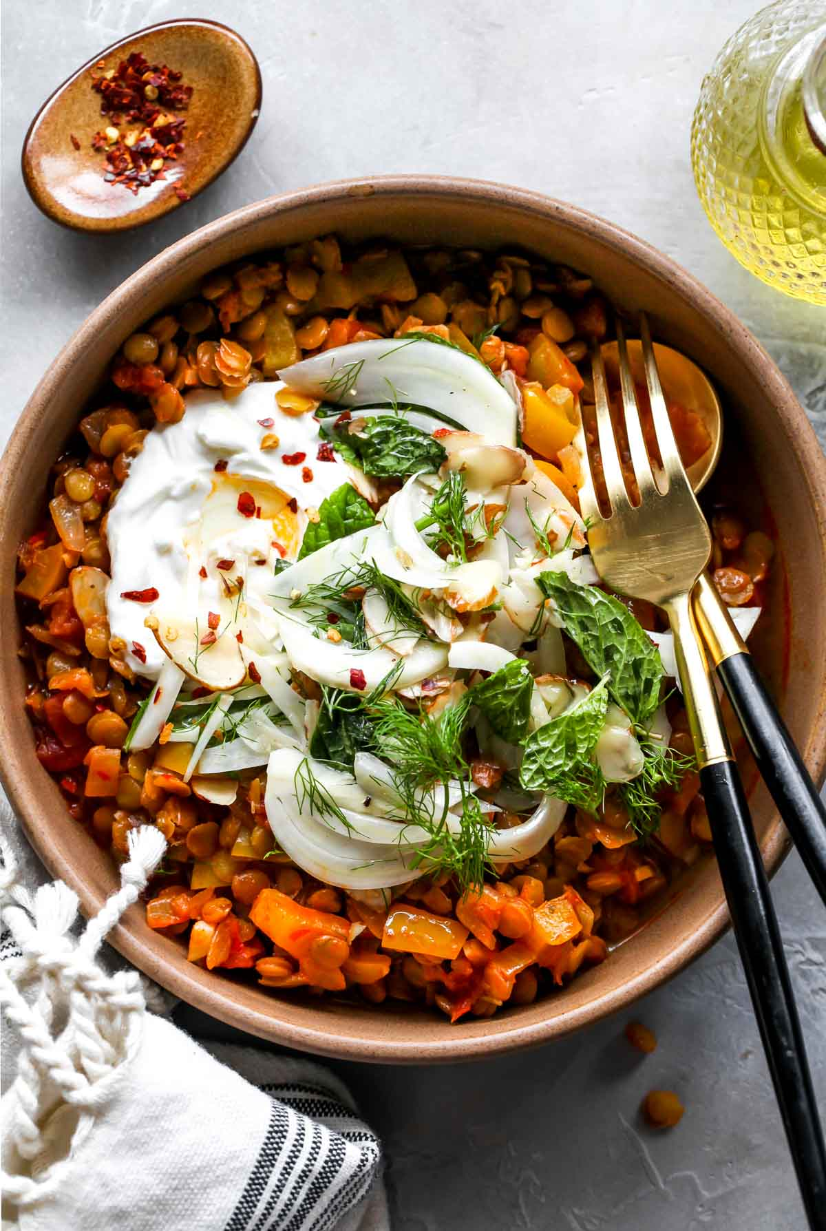 A bowl of harissa lentils with fennel slaw and a dollop of yogurt