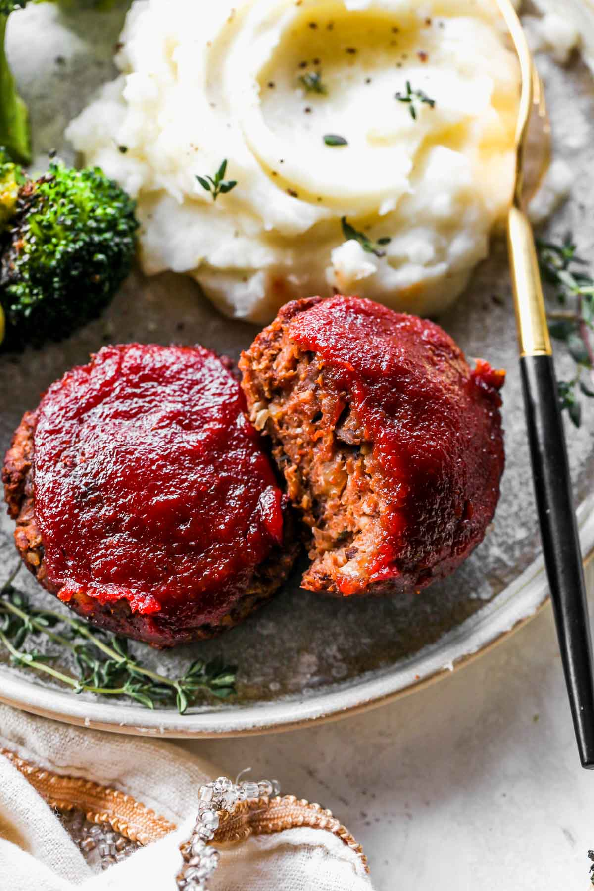 Vegetarian meatloaf mini being sliced into on a plate