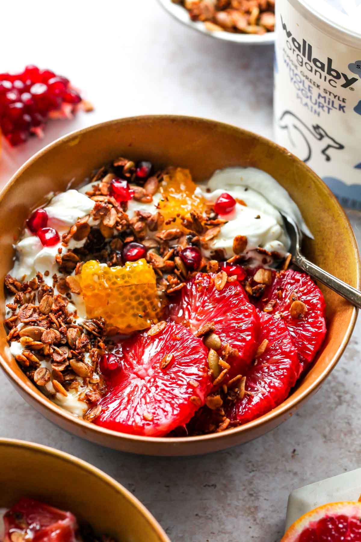Protein granola served over yogurt with orange slices