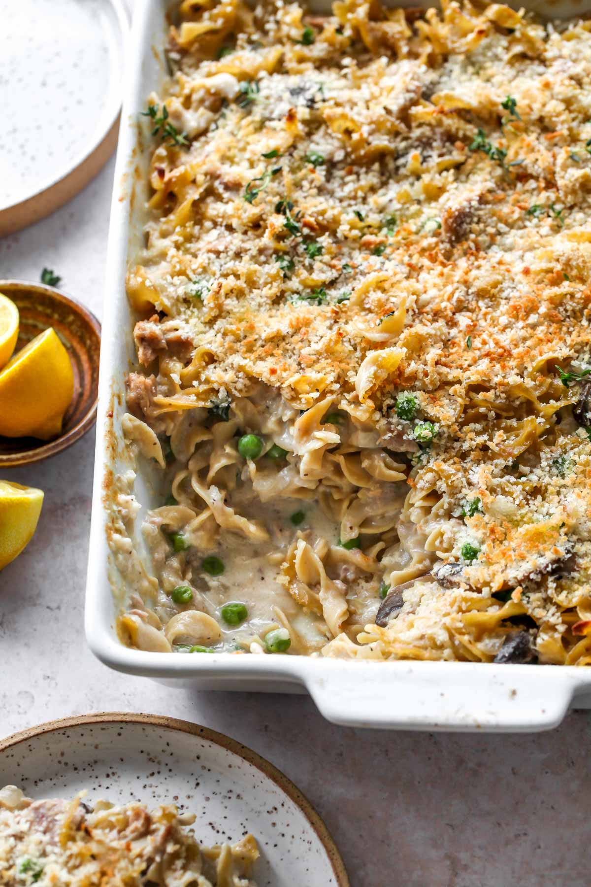 Homemade Tuna Noodle Casserole in a white dish with a serving scooped out
