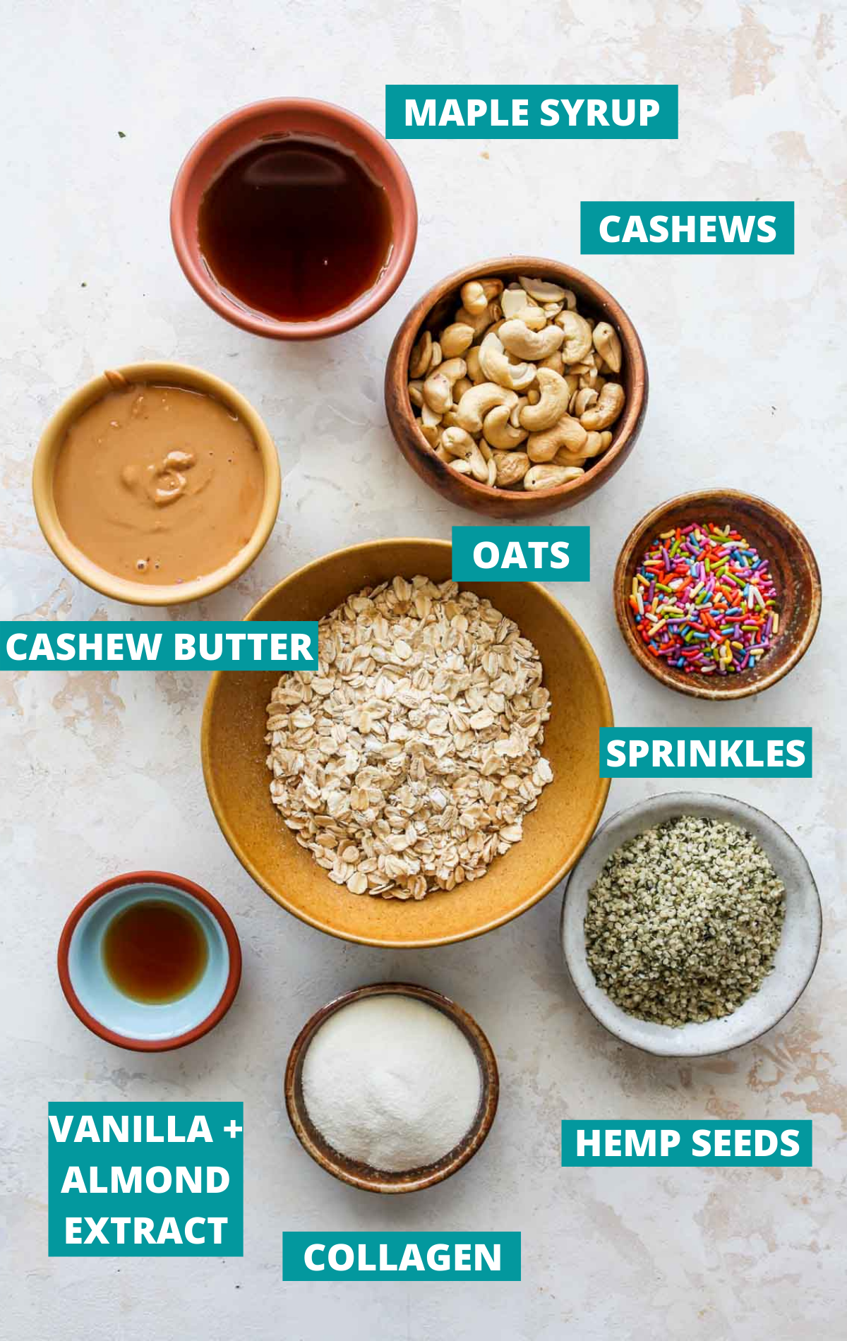Recipe ingredients in separate bowls on a white board